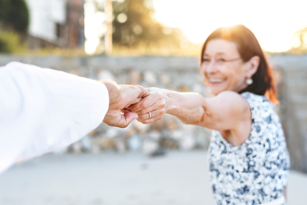 Older woman reaching out and holding another hand